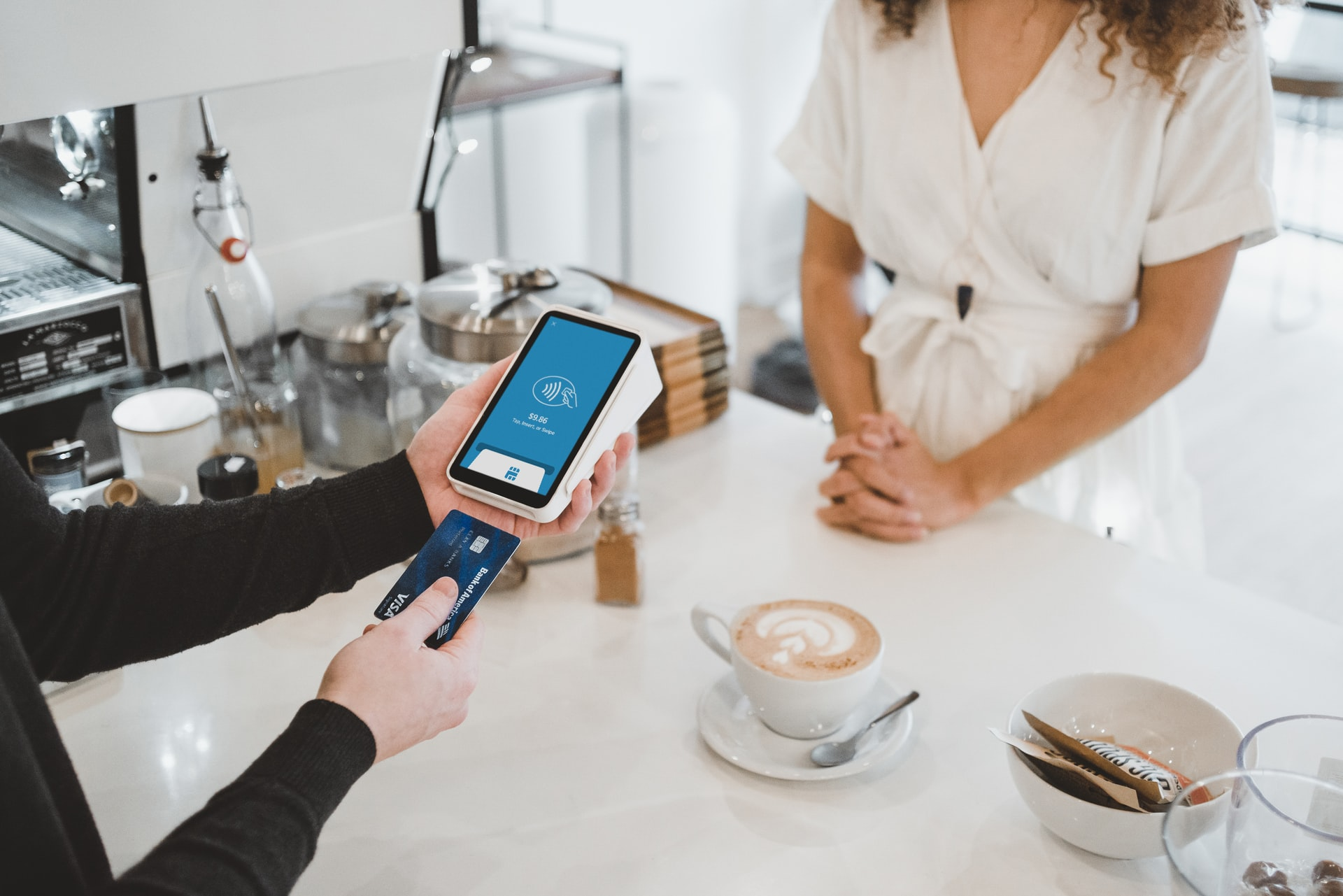 credit card being used at a coffee shop