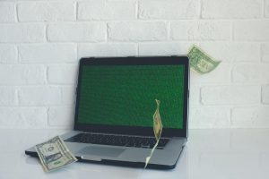 Money in front of a laptop