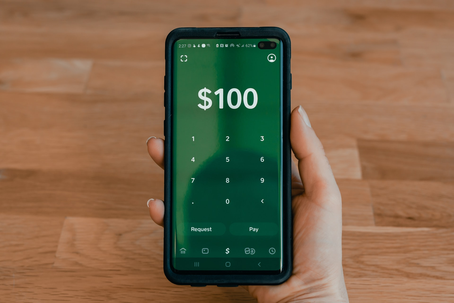 Cell phone showing 100 dollars processed through eCheck verification